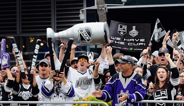 LOS ANGELES, CA - JUNE 14: Fans cheer during the Los Angeles Kings Stanley Cup victory parade on June 14, 2012 in Los Angeles, California. The Kings are celebrating thier first NHL Championship in the team's 45-year-old franchise history. (Photo by Kevork Djansezian/Getty Images)