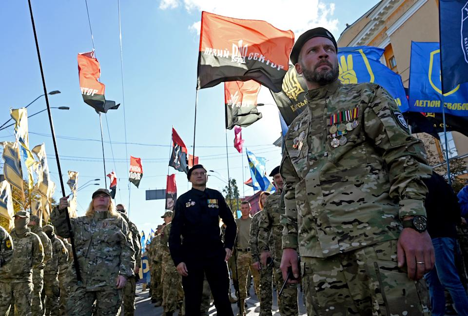 Ukrainian war veterans march as Nationalists movements demonstrate in front of President Volodymyr Zelensky's offices in Kiev in October last year. Source: Getty Images