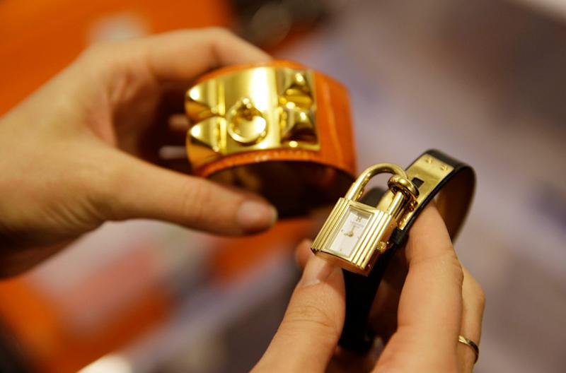 A Hermes Collier de Chien bracelet and a Hermes Kelly Double Tour from The RealReal