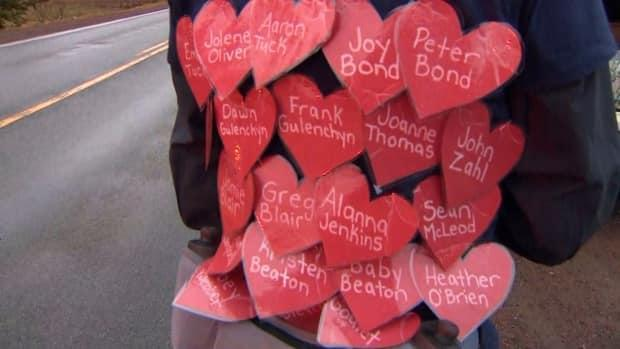Arany ran the marathon wearing a Nova Scotia Strong sweater with the names of the victims on hearts attached to her back.