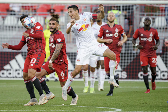 New York Red Bulls midfielder Sean Davis (27) heads the ball during the first half of an MLS soccer match against Toronto FC on Wednesday, July 21, 2021, in Toronto. (Chris Katsarov/The Canadian Press via AP)