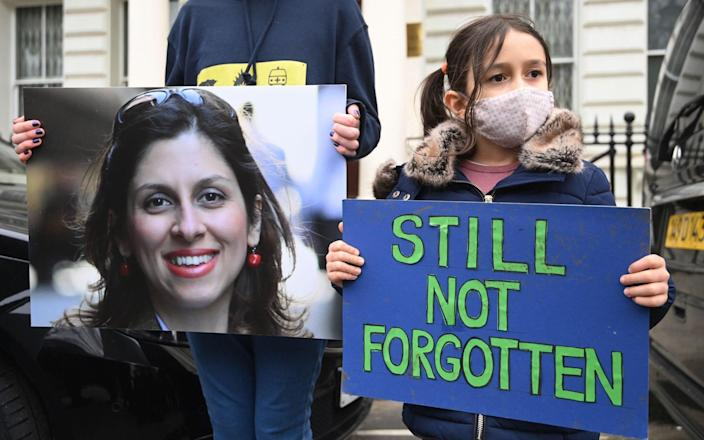 Nazanin Zaghari-Ratcliffe's daughter Gabriella during a protest outside the Iranian Embassy last month - Shutterstock