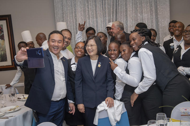 "In this photo released by the Taiwan Presidential Office, Taiwanese President Tsai Ing-wen poses for photos in St. Lucia on Thursday, July 18, 2019. Tsai said she would follow ""humanitarian principles"" in dealing with asylum seekers from Hong Kong during a visit this week to Saint Lucia, an eastern Caribbean island nation that is among Taiwan's few remaining allies. (Taiwan Presidential Office via AP)"