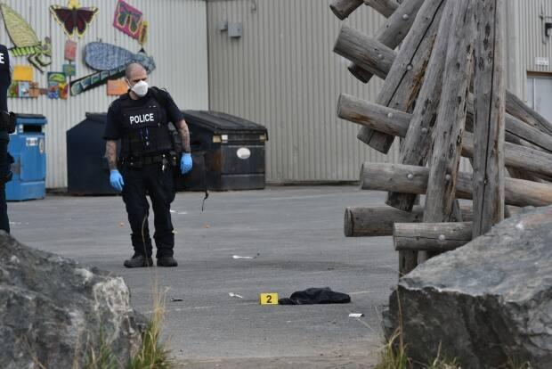 RCMP gather and bag evidence at a taped off crime scene in downtown Yellowknife late Wednesday afternoon.