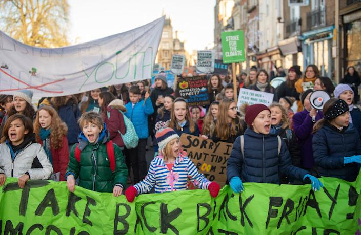 Children take part in the YouthStrike4Climate march in Cambridge, England, Friday Nov. 29, 2019.
