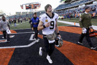 New Orleans Saints quarterback Drew Brees (9) reacts as he runs off the field following an NFL football game against the Cincinnati Bengals, Sunday, Nov. 11, 2018, in Cincinnati. (AP Photo/Frank Victores)