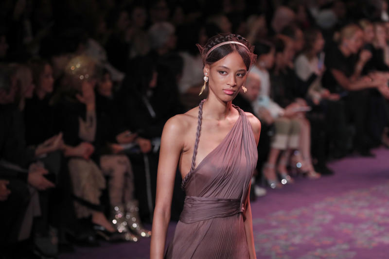 A model wears a creation for the Dior Haute Couture Spring/Summer 2020 fashion collection presented Monday Jan. 20, 2020 in Paris. (AP Photo/Francois Mori)