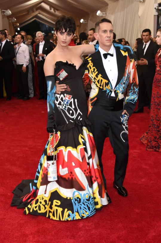 """<p>Katy Perry in Moschino.</p><p>Katy Perry, with her date and dress designer Jeremy Scott, is wearing a gown straight off his recent runway show. She completed the graffiti look wearing her """"Kris Jenner"""" wig.</p>"""