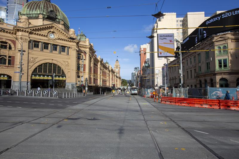 MELBOURNE, AUSTRALIA - MARCH 30: A deserted Flinders Street train station on March 30, 2020 in Melbourne, Australia. Public gatherings are now limited to two people, as the Australian Government introduces tougher restrictions in response to the COVID-19 pandemic. Prime Minister Scott Morrison on Sunday told Australians to stay home unless they are shopping for food, receiving medical attention, going to work or education, or for exercise, which is now limited to groups of two. People over 70 have been told to remain inside while public areas such as playgrounds, outside gyms and skateparks will be closed from midday on Monday. International arrivals into Australia are being quarantined in hotels on arrival. (Photo by Bill Blair#JM/Getty Images)