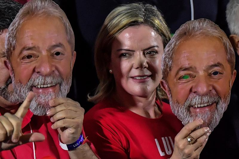 Brazilian senator and president of the Workers' Party (PT), Gleisi Hoffmann, holds a mask depicting Brazilian former president Luiz Inacio Lula da Silva, during the national convention of the Workers Party (PT), in Sao Paulo, Brazil on August 04, 2018. - Even though he's behind bars, Brazil's Luiz Inacio Lula da Silva was set to secure his leftist party's nomination Saturday, maintaining him as the most-watched candidate in the country's least predictable presidential election for decades. (Photo by NELSON ALMEIDA / AFP) (Photo credit should read NELSON ALMEIDA/AFP/Getty Images)