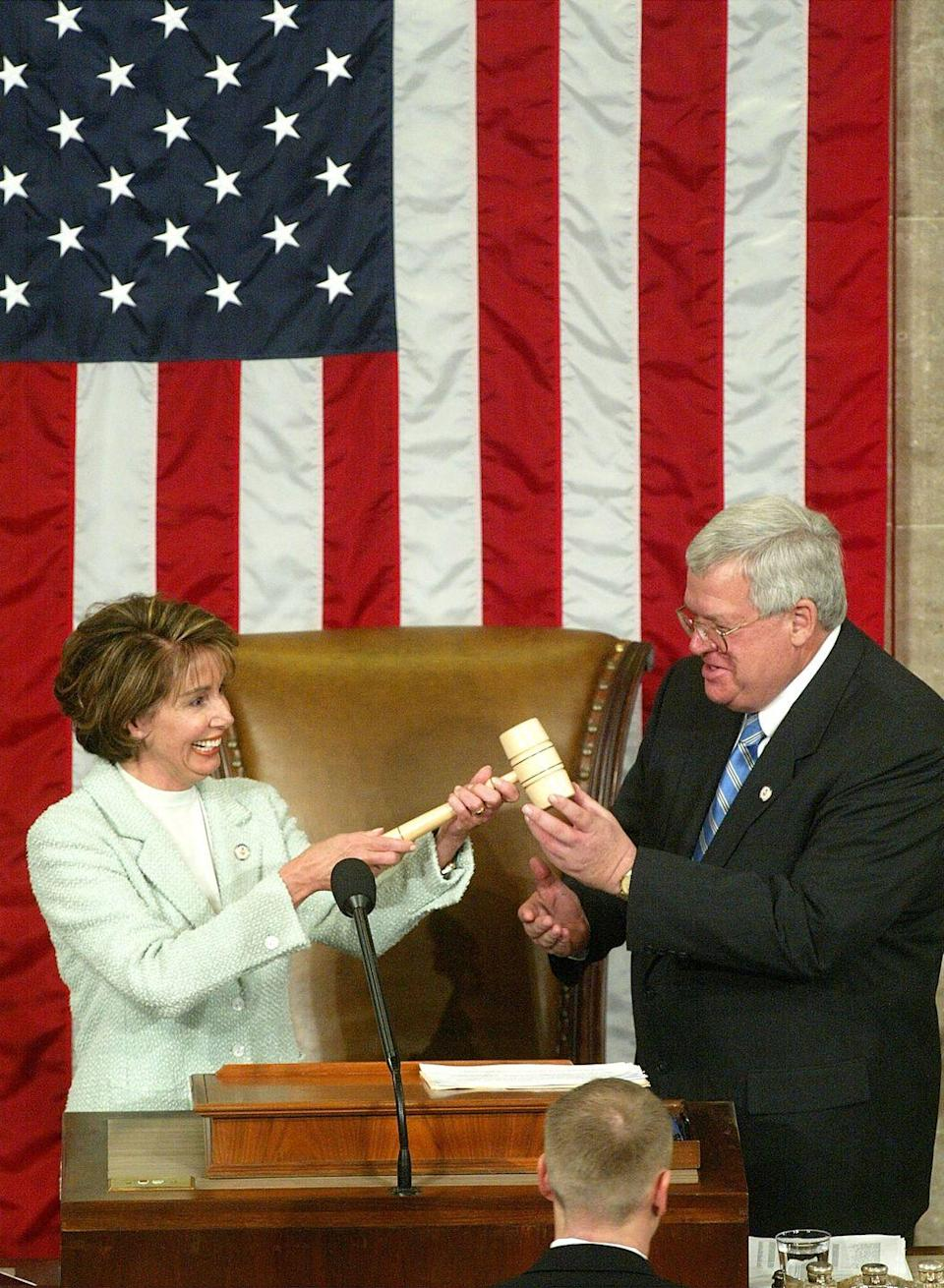<p>Pelosi is sworn in as House Minority Leader during the opening day of the 108th Congress. </p>
