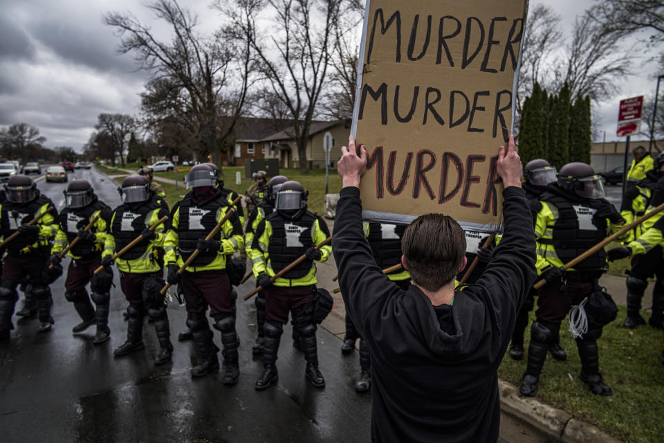 Protesters confront police over the shooting death of Daunte Wright at a rally at the Brooklyn Center Police Department in Brooklyn Center, Minn., Monday, April 12, 20121. (Richard Tsong-Taatarii/Star Tribune via AP)