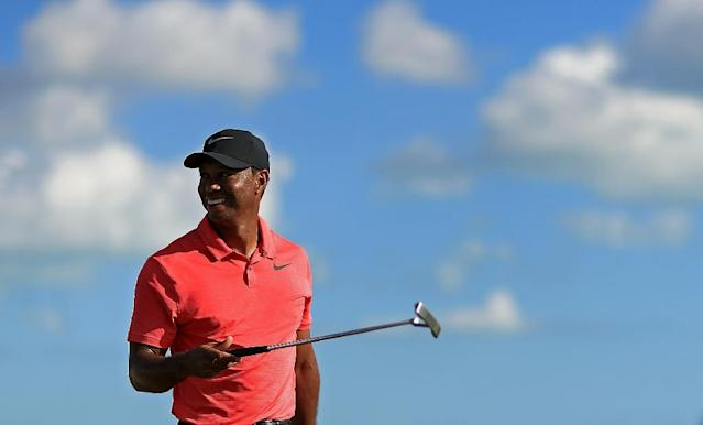 Tiger Woods, pictured in December 2017, is sure to be the focus of attention in his first official US PGA Tour event since back surgery last April that sidelined him nearly 10 months (AFP Photo/Mike Ehrmann)