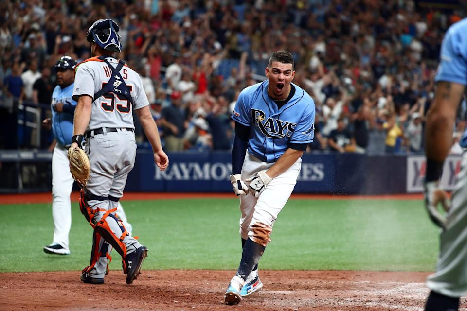 Tampa Bay Rays shortstop Willy Adames celebrates as he scores the winning run during the ninth inning to beat the Detroit Tigers, 5-4, at Tropicana Field on Aug. 18, 2019 in St. Petersburg, Fla.