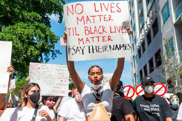 PHOTO: Demonstrators hold signs and chant as they protest police brutality in at Bayfront Park in downtown Miami, May 30, 2020 in response to the recent death of George Floyd. (Adam Delgiudice/AFP/Getty Images)
