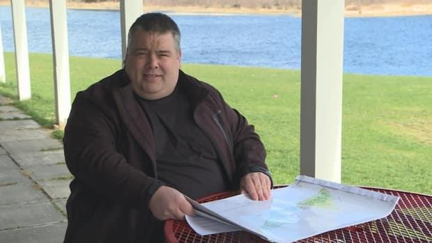 Jon Stirling reviews some of the designs for the Deer Lake RV park, which he purchased in 2019. He says misinformation is circulating about the development and its environmental impact.