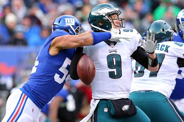 <p>Philadelphia Eagles quarterback Nick Foles (9) fumbles the ball as he is sacked by New York Giants defensive end Olivier Vernon (54) during the first quarter at MetLife Stadium. Mandatory Credit: Brad Penner-USA TODAY Sports </p>