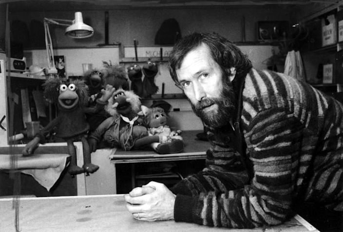 "FILE- In this Feb. 6, 1984, file photo, Jim Henson with his ""Muppets"" pose for a photo at Henson's 69th Street office in New York. A New York City museum is asking fans of Jim Henson's Muppets to help pay for an exhibition featuring original puppets of beloved characters like Elmo, Miss Piggy and Kermit the Frog. The Museum of the Moving Image launched a Kickstarter campaign Tuesday, April 11, 2017, seeking $40,000 to help preserve the puppets for posterity. (AP Photo/G. Paul Burnett, File)"
