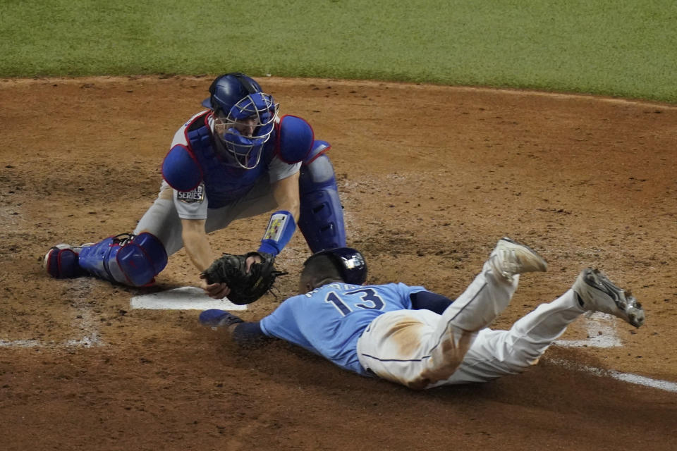 Tampa Bay Rays' Manuel Margot is tagged out at home by Los Angeles Dodgers catcher Austin Barnes trying to steal during the fourth inning in Game 5 of the baseball World Series Sunday, Oct. 25, 2020, in Arlington, Texas. (AP Photo/Sue Ogrocki)
