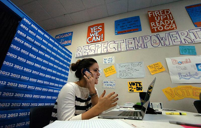 FILE - In this Nov. 6, 2012 file photo, Taylor Pineiro, of New York, a deputy field organizer for the Obama campaign, works the phone at a field office in Scranton, Pa., on Election Day. Republicans are moving aggressively to repair their technological shortcomings from the 2012 election, opening a new tech race to counter a glaring weakness against President Barack Obama last year.  (AP Photo/Scranton Times & Tribune, Butch Comegys, File)  WILKES BARRE TIMES-LEADER OUT; MANDATORY CREDIT