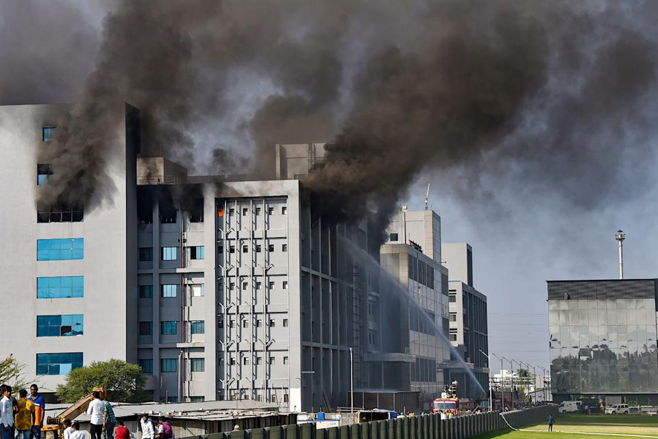 Smoke billows out after a massive fire broke out at the Serum Institute of India, in Pune, Thursday, 21 January 2021. The facility had rolled out its Covishield vaccine for the first phase of COVID vaccination drive that began on 16 January.