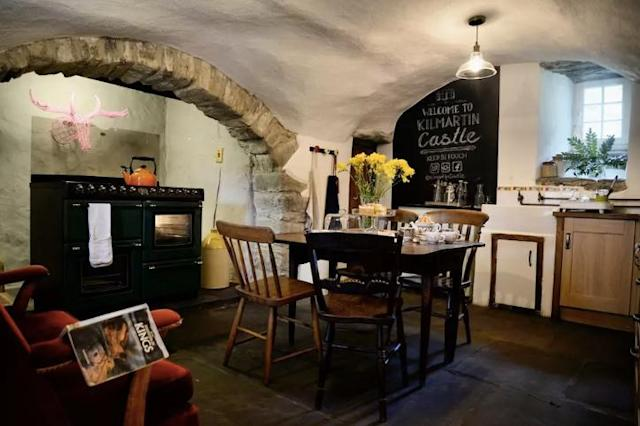 <p>The kitchen has been modernized but still maintains a rustic feel. </p>