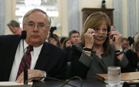General Motors Chief Executive Mary Barra (R) and the company's general counsel Michael Millikin appear before the Senate Commerce, Science and Transportation Subcommittee in Washington July 17, 2014. REUTERS/Gary Cameron