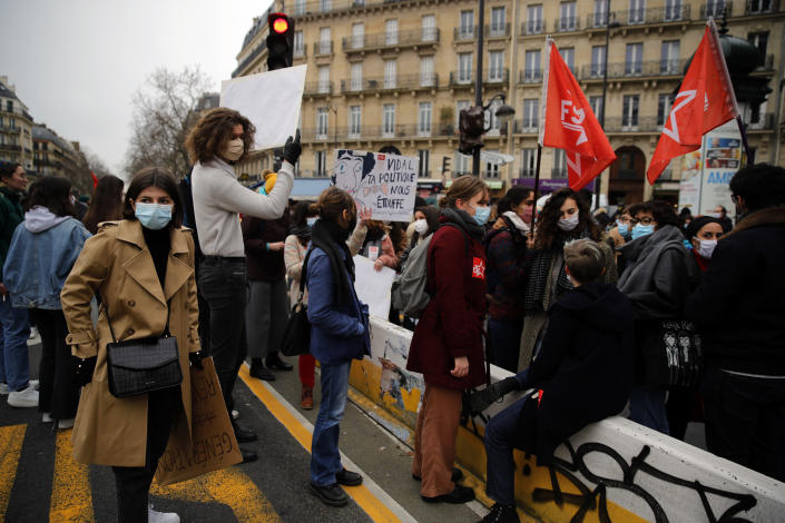 Students gather during a protest in Paris, Tuesday Jan.26, 2021. Schoolteachers and university students marched together in protests or went on strike Tuesday around France to demand more government support amid the pandemic. (AP Photo/Christophe Ena)