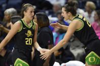 Oregon's Sabrina Ionescu, left, slaps hands with Oregon's Erin Boley, right, in the second half of an NCAA college basketball game, Monday, Feb. 3, 2020, in Storrs, Conn. (AP Photo/Jessica Hill)
