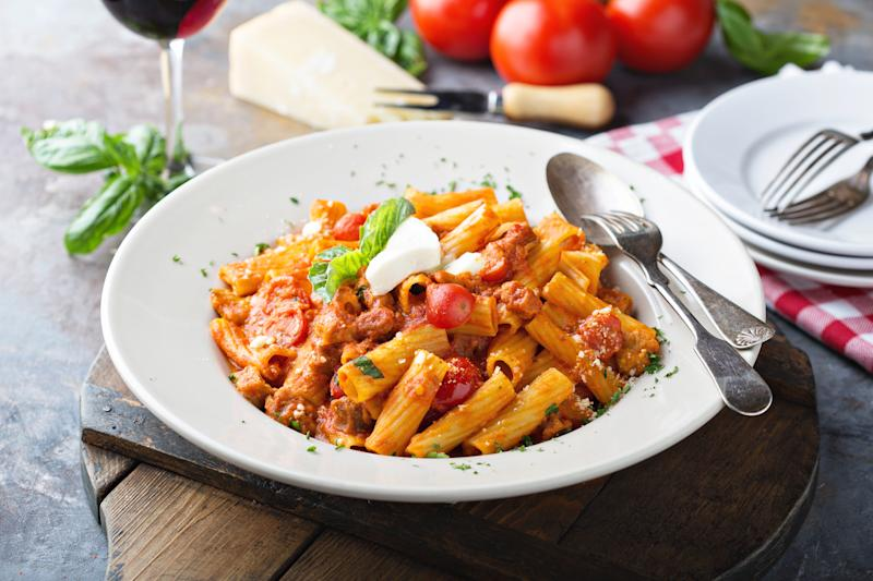 Rigatoni bolognese with fresh mozzarella and basil in a big plate. (Photo: Getty Images)