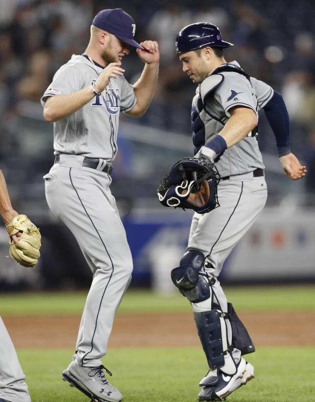 Tampa Bay Rays' Austin Meadows, left, dances with Tampa Bay Rays' catcher Travis d'Arnaud after they defeated the New York Yankees in a baseball game, Monday, July 15, 2019, in New York. (AP Photo/Kathy Willens)