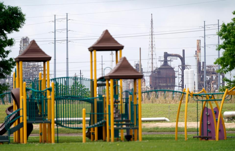<p>In this Monday, March 23, 2020 file photo, a playground outside the Prince Hall Village Apartments sits empty near one of the petrochemical facilities in Port Arthur, Texas. According to a study published Wednesday, April 28, 2021 in the journal Science Advances,  across America, people of color are disproportionately exposed to air pollution from industry, vehicles, construction and many other sources. (AP Photo/David J. Phillip)</p> (AP)
