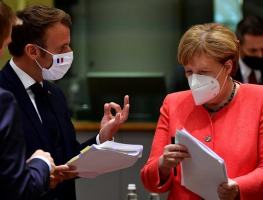 The EU leaders' summit began with smiles and COVID-proof elbow bumps, but soon got down to tense negotiations
