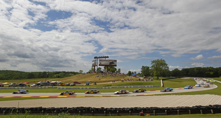 FILE - Drivers race through a turn in the Bucyrus 200 Nascar Nationwide series race at Road America in Elkhart Lake, Wi., in this Saturday, June, 19, 2010, file photo. Road America owns a reputation as one of the nation's foremost road courses, but it hasn't hosted a NASCAR Cup Series event since the 1950s. (AP Photo/Jeffrey Phelps, File)