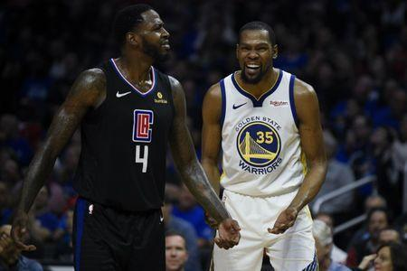 Apr 18, 2019; Los Angeles, CA, USA; Golden State Warriors forward Kevin Durant (35) and Los Angeles Clippers forward JaMychal Green (4) both react after they both receive a technical foul during the second half in game three of the first round of the 2019 NBA Playoffs at Staples Center. Mandatory Credit: Kelvin Kuo-USA TODAY Sports
