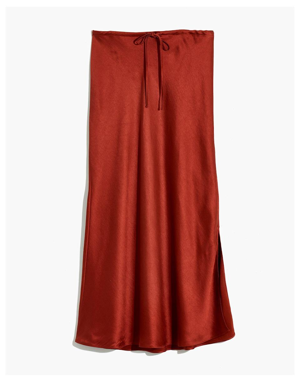 """<p><strong>Madewell</strong></p><p>madewell.com</p><p><a href=""""https://go.redirectingat.com?id=74968X1596630&url=https%3A%2F%2Fwww.madewell.com%2Fdrawstring-midi-slip-skirt-MA980.html&sref=https%3A%2F%2Fwww.cosmopolitan.com%2Fstyle-beauty%2Ffashion%2Fg36065935%2Fmadewell-spring-sale-2021%2F"""" rel=""""nofollow noopener"""" target=""""_blank"""" data-ylk=""""slk:SHOP NOW"""" class=""""link rapid-noclick-resp"""">SHOP NOW</a></p><p><strong><del>$88</del> $53 (40% off)</strong><br></p><p>If, after a year of being cooped up inside because of the global pandemic, you're after something that feels just a 'lil more fancy than baggy sweatpants, behold this '90s-feeling slip skirt. It has a slight leg-baring slit and can be dressed up or down. </p>"""