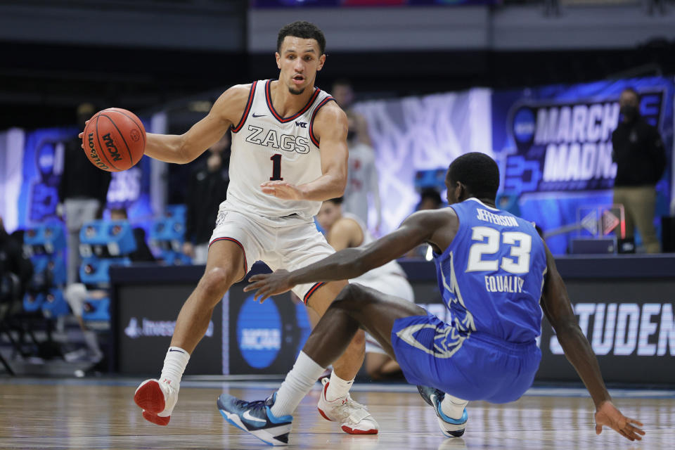 Gonzaga's Jalen Suggs dribbles past Creighton's Damien Jefferson during a Sweet 16 game on March 28. (Sarah Stier/Getty Images)