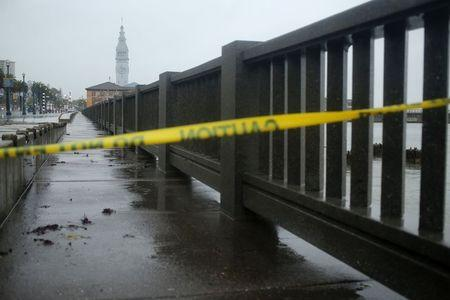 Police tape is pictured on the Embarcadero, which is closed due to the weather, in San Francisco, California December 11, 2014. REUTERS/Robert Galbraith