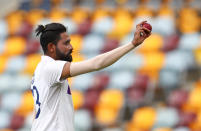 India's Mohammed Siraj gestures with the ball as he leaves the field after taking five wickets during play on day four of the fourth cricket test between India and Australia at the Gabba, Brisbane, Australia, Monday, Jan. 18, 2021. (AP Photo/Tertius Pickard)