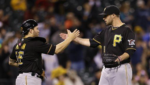 Pittsburgh Pirates catcher Russell Martin, left, and closing pitcher Duke Welker congratulate each other after the team beat the Seattle Mariners in a baseball game Tuesday, June 25, 2013, in Seattle. The Pirates won 9-4. (AP Photo/Elaine Thompson)