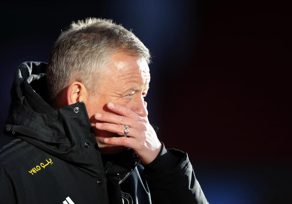 Sheffield United's manager Chris Wilder gestures during a warm up before the English Premier League soccer match between Sheffield United and West Ham United at Bramall Lane stadium in Sheffield, England, Sunday, Nov. 22, 2020. (Mike Egerton/Pool via AP)