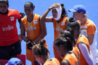 Members of the India women's field hockey team cool off during a training session at Oi Hockey Stadium ahead of the the 2020 Summer Olympics, Thursday, July 22, 2021, in Tokyo, Japan. (AP Photo/John Locher)