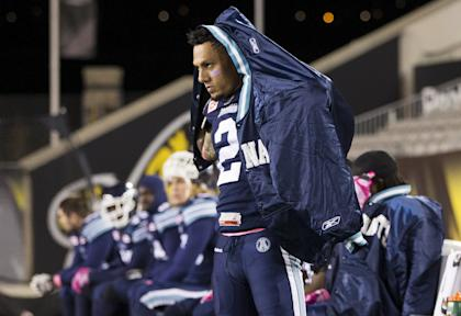 Toronto Argonauts' Chad Owens puts his jacket on on the sidelines as his team plays the Montreal Alouettes furing the second half of their CFL football game in Hamilton, Ontario, Canada, October 23, 2015. The game was moved from the Rogers Centre in Toronto to Hamilton at Tim Hortons Field due to scheduling conflicts with the Toronto Blue Jays baseball playoffs schedule. REUTERS/Mark Blinch