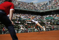 FILE - In this June 5, 2013, file photo, Russia's Maria Sharapova returns the ball to Serbia's Jelena Jankovic during their quarterfinal match of the French Open tennis tournament at Roland Garros stadium in Paris. (AP Photo/Petr David Josek, File)