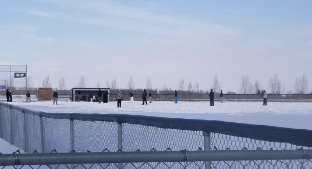 """This photo shows a group of athletes playing a snow-filled game of baseball in Leduc, Alta. The image was posted on Reddit on Monday. Photo from <a href=""""https://www.reddit.com/r/Torontobluejays/comments/art3hc/they_were_playing_baseball_in_leduc_just_outside/?sort=new"""">Reddit</a> ."""