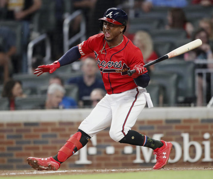 Atlanta Braves second baseman Ozzie Albies stumbles as he bats against the Milwaukee Brewers during the sixth inning of a baseball game Friday, May 17, 2019, in Atlanta. (AP Photo/John Bazemore)