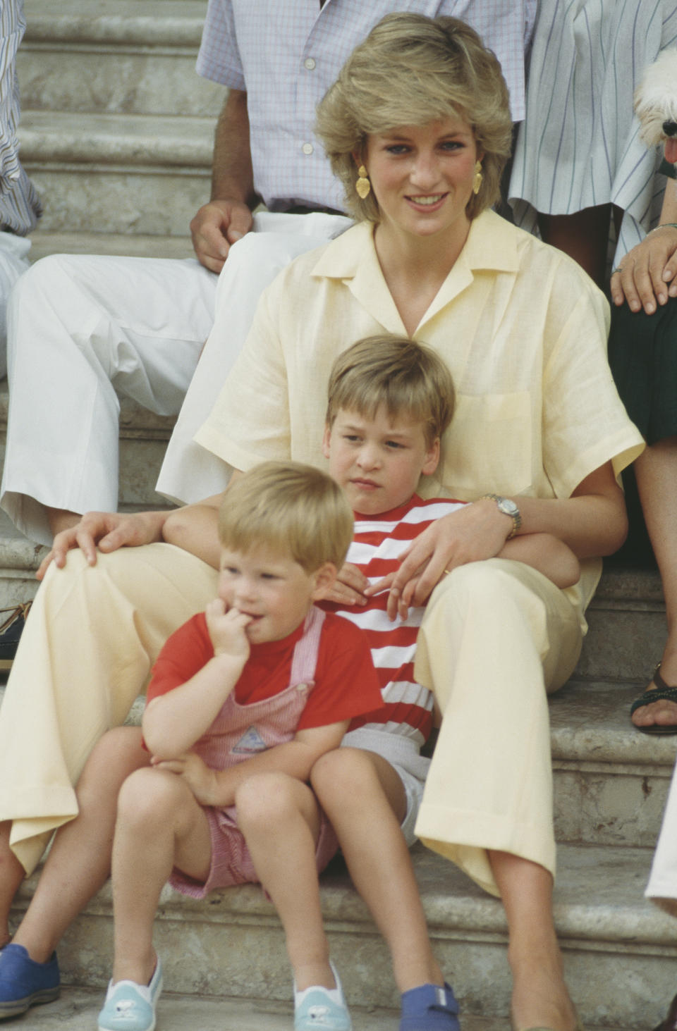 <p>William and Harry sitting with their mother Diana during a holiday with the Spanish royal family at the Marivent Palace in Palma de Mallorca, Spain, in August 1987. (Terry Fincher/Princess Diana Archive/Getty Images)</p>