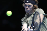 Andrey Rublev of Russia returns the ball to Dominic Thiem of Austria during their doubles tennis match at the ATP World Finals tennis tournament at the O2 arena in London, Thursday, Nov. 19, 2020. (AP Photo/Frank Augstein)