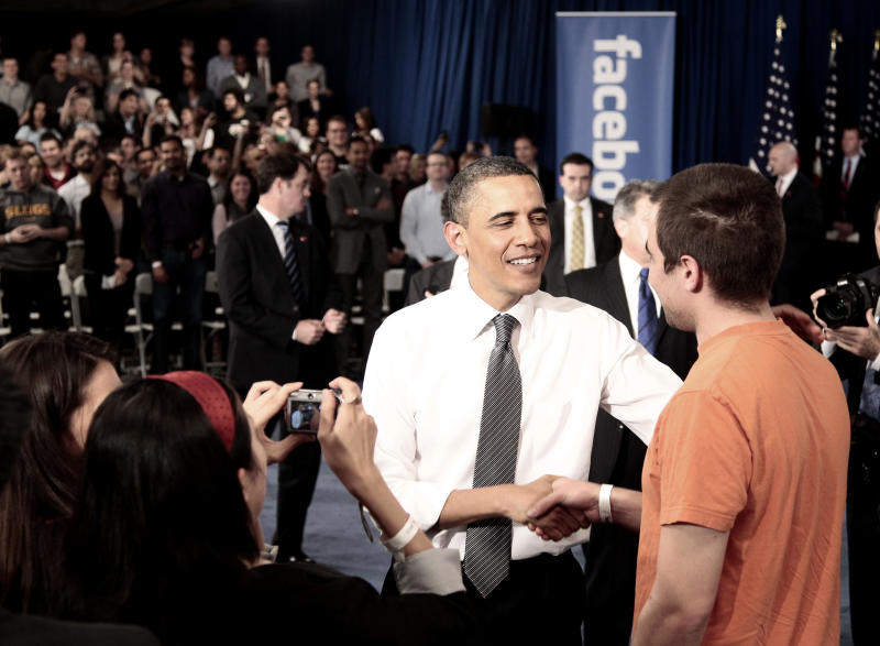 President Barack Obama shakes hands with a member of the audience at a town hall meeting to discuss reducing the national debt, Wednesday, April 20, 2011, at Facebook headquarters in Palo Alto, Calif. (AP Photo/Pablo Martinez Monsivais)