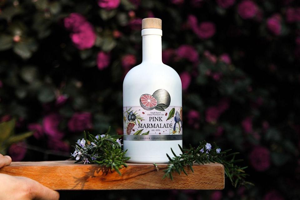 "<p><a class=""link rapid-noclick-resp"" href=""https://pinkmarmaladegin.co.uk/product/colour-changing-gin/"" rel=""nofollow noopener"" target=""_blank"" data-ylk=""slk:SHOP"">SHOP</a></p><p>Comes out looking like a blue lagoon and changes to the colour of Parma Violets when mixed with tonic. Leaves you feeling like you've just eaten fizzy-sour sweets, and is undeniably one for a party. Garnish with a sliver of pink grapefruit peel.</p><p>£30 / 50cl; 42 per cent ABV</p>"
